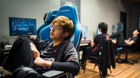 23Savage at Beyond the Summit sitting relaxed in a gaming chair