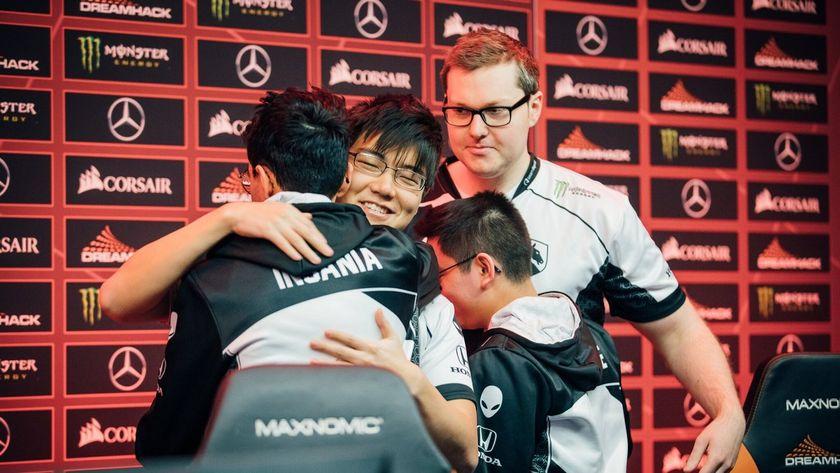 Team Liquid players hugging their coach at DreamLeague