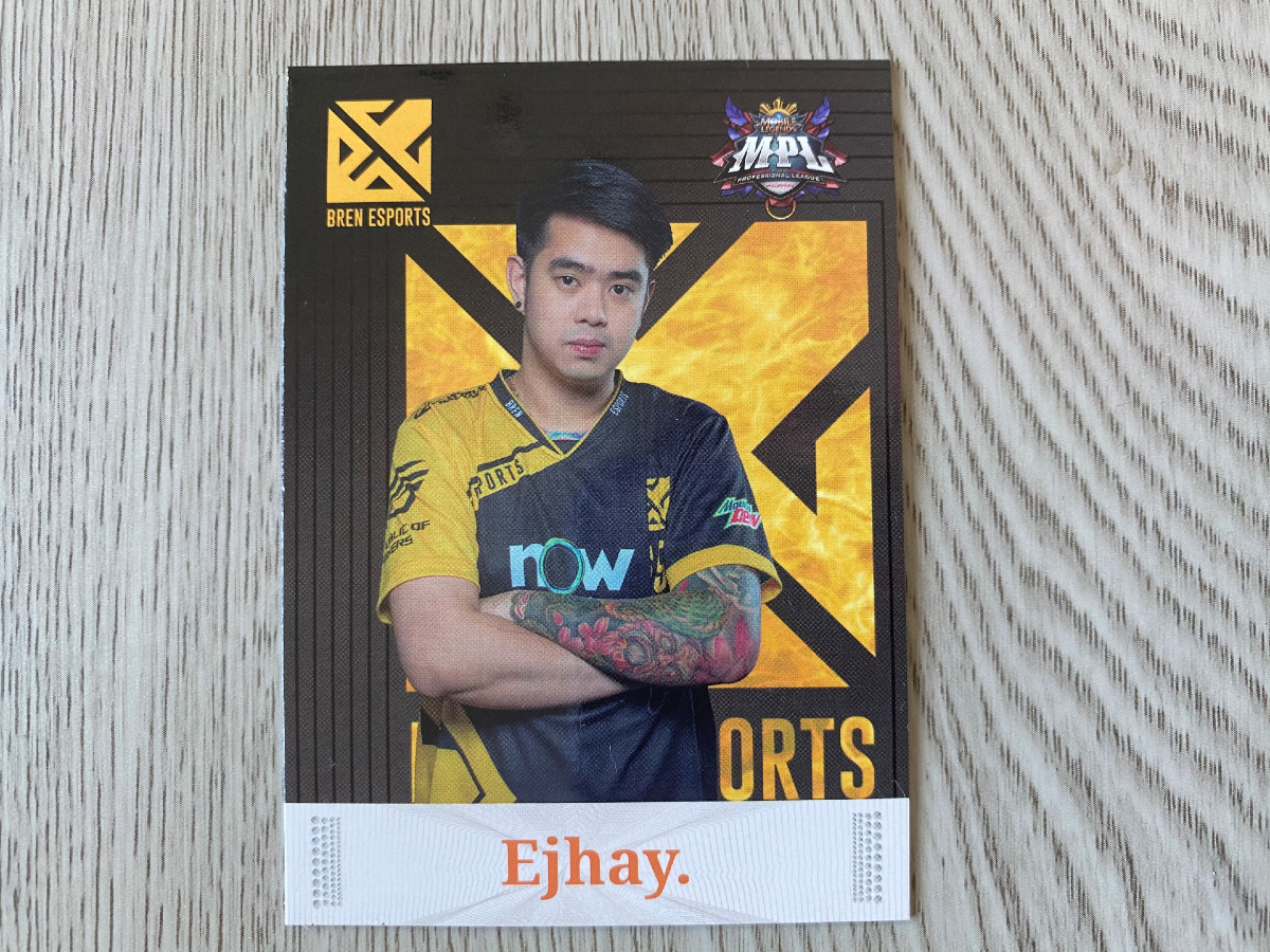 Ejhay standing with arms crossed Player card