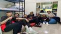 Cignal Ultra team sitting on the floor