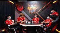Bigetron Alpha MLBB team sitting around a table
