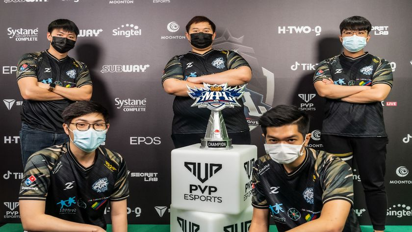 EVOS SG standing around MPL SG trophy after winning