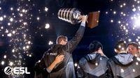 Team Secret lifting the trophy at ESL One