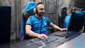 KuroKy of Team Nigma looking happy while playing Dota 2