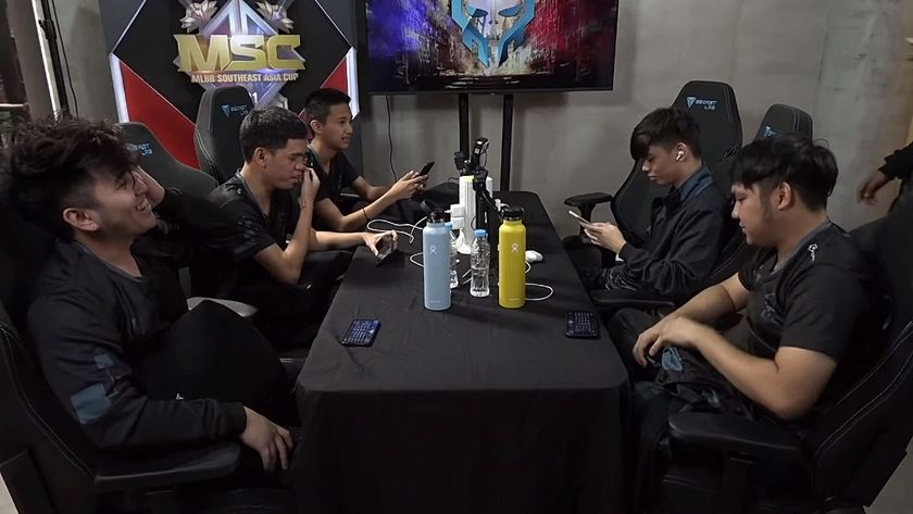 Execration MLBB team sitting around a table post game